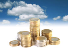 Coins on blue sky. Stock Photography