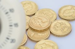 Coins with blurred timer Stock Photo