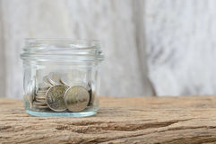 Coins in bottle Royalty Free Stock Image