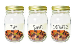 Coins in bottle with Tax Saving Donate plan label on white backg Stock Photos