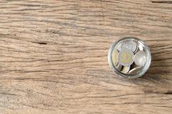 Coins in bottle Stock Photography
