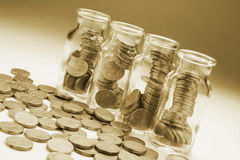 Coins in Bottles Stock Photo