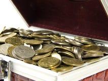 Coins in box Stock Photos