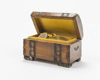 Coins in the box. Old open treasure box with gold coins stock photography