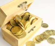 Coins in a box. Coins in a wooden box on white back ground Royalty Free Stock Images
