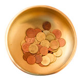 Coins in a brass bowl at Temple Stock Photography
