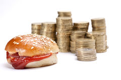 Coins and bread Stock Photo