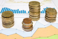 Coins and business charts Stock Photography