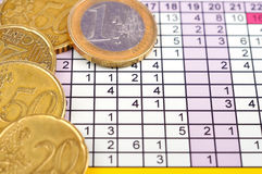 Coins and business report Royalty Free Stock Photography