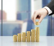 Coins. Businessman hand holding coins in office Royalty Free Stock Photo