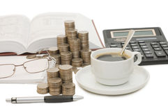 Coins and the calculator Royalty Free Stock Image