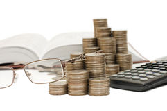 Coins and the calculator Stock Images