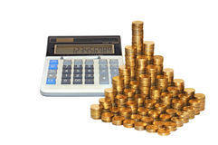 Coins and calculator Stock Photography