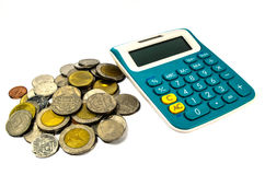 Coins and calculator Royalty Free Stock Photos