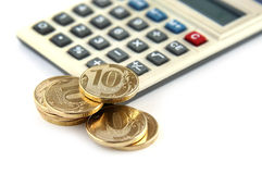 Coins and calculator Stock Image