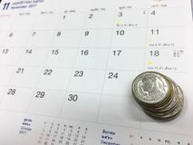 Coins on calendar get to saving. Saving date number money Stock Image
