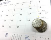 Coins on calendar. Saving date number money Stock Photography