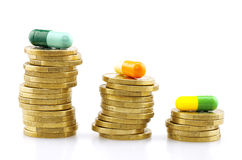 Coins and capsules, medical expenses Stock Image