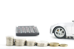 Coins with car and calculator Stock Photos