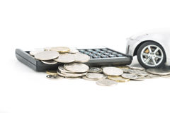 Coins. A car, calculator and coins  on a white background Royalty Free Stock Image