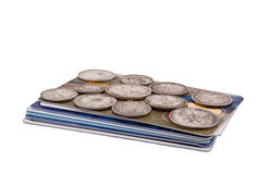 Coins on cards. Old silver coins are on the new credit card Stock Photography