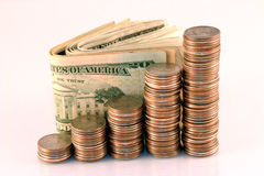 Coins and cash. Ascending coins with cash in the background Stock Photography