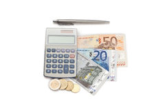 Coins and cash with pen and pocket calculator Royalty Free Stock Photos