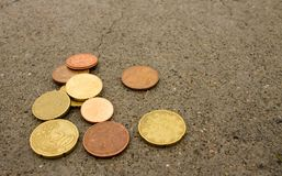 Coins on the cement floor stock photo