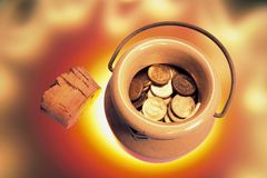 Coins in Ceramic Jar Stock Images
