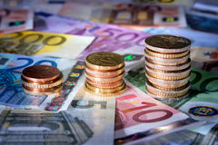 Coins chart on euro banknotes stock exchange, money in rise