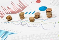 Coins and charts Stock Photography