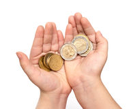 Coins in child's hand Royalty Free Stock Images