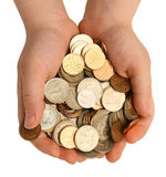 Coins in the children's palms Stock Images