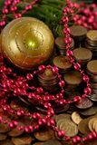 Coins with Christmas decorations Stock Photo