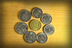 The coins are in a circle. Indian coins of 1 rupee and 5 rupee Stock Photography