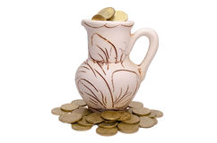 Coins in a clay jug Royalty Free Stock Photography