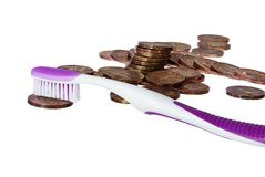 Coins cleaning. With a purple toothbrush, isolated on white Royalty Free Stock Image