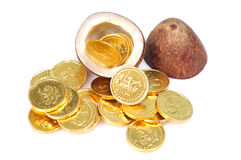 Coins and coconut Stock Image