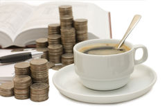 Coins and a coffee cup. Isolated royalty free stock photography