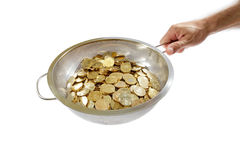 Coins in colander Royalty Free Stock Photo