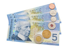 Coins and colorful bills of Canada. Stock Images
