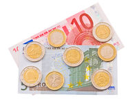Coins and colorful bills. stock images