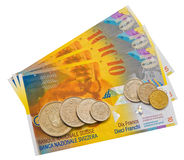 Coins and colorful bills. Royalty Free Stock Photo