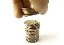 Coins column with fingers royalty free stock photo