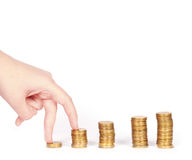 Coins column and fingers isolated Royalty Free Stock Photo