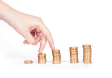 Coins column and fingers Stock Photos