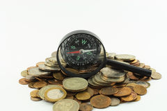 Coins and compass Stock Photos