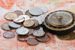Coins and compass on the map Stock Image