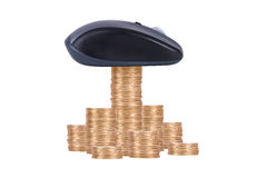 Coins with Computer Mouse Royalty Free Stock Photography