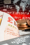 Coins, credit cards and british pounds on newspaper Royalty Free Stock Images